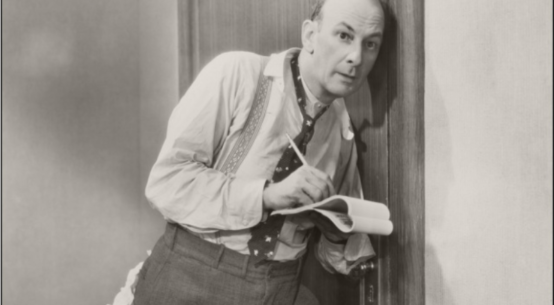 Black and white photograph of a man eavesdropping and taking notes. from: PWCD - Neighbor Harassment.