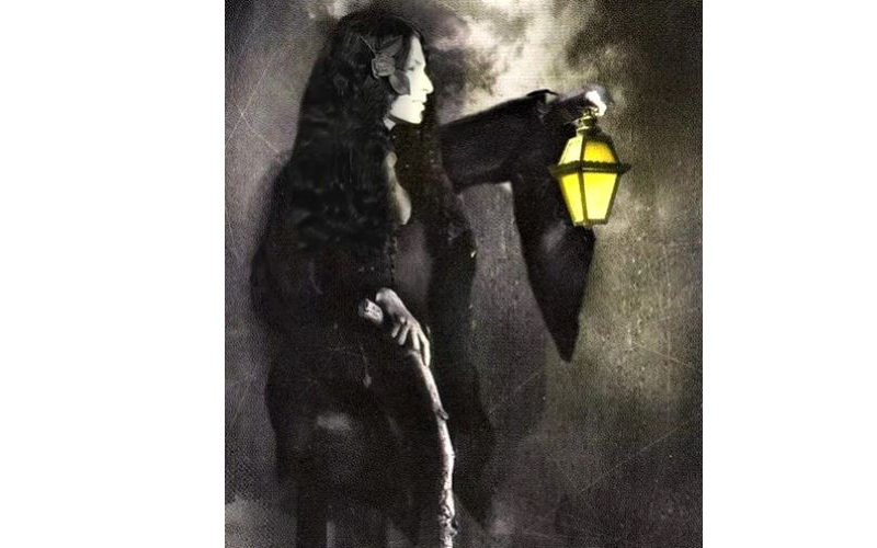 Photo of shekhinahmountainwater dressed in black and holding a lantern. from: PWCD - Goddess Movement -